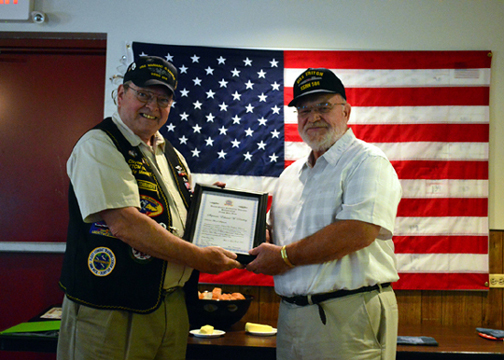 Ed Dowling accepts Holland Club Membership from CDR Hill