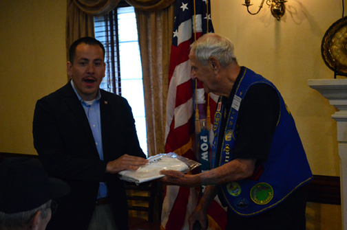 Bob recieves Il. flag from Mr. Garcia