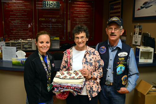Greg & Mary Miller present pillowcases to Lindsay Wadas, O'Hare Center Director