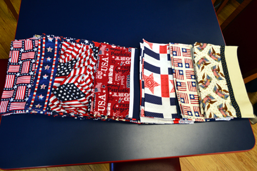 Assorted Patriotic Pillow Cases handmade by various Crash Dive Members Wives, and many thanks to Judy Struck, Eileenmary King, and Donna Bowers, members of Needle's Nest Chapter of EGA, for their contributions