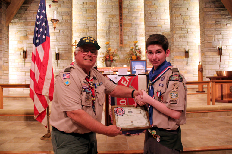 Ryan P. Zakin, New Eagle Scout, Troop 13, Fox Valley District-Three Fires Council, receives his award from Mr. Ted Rotzoll, Crash Dive Base Member and Council Leader
