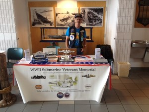 Greg Miller setting up in the Wisconsin Maritime Museum with donations going towards the WWII Submarine Veterans Memorial